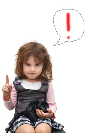 frowns: little confident girl muse lifted a finger up your digital camera keeps up with idea Stock Photo