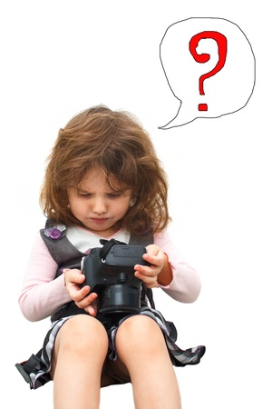 frowns: little girl sitting holding digital camera and thoughtful frown isolated on white background