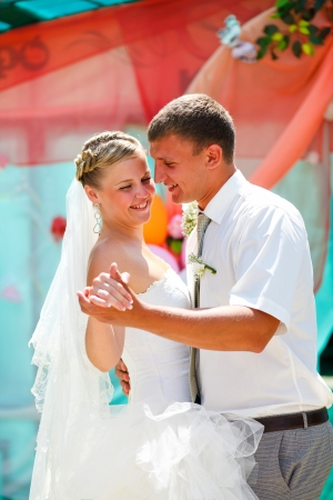couple bride and groom kissing newlyweds on wedding day dance Stock Photo