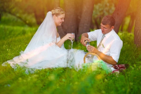 couple picnic in forest glade photo