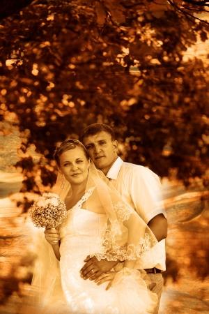 bri: retro sepia photo couple wedding are in green summer forest, bri