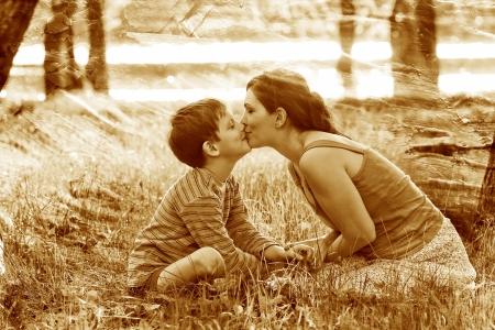 retro sepia photo, Mom son of woman and child sitting on gra photo