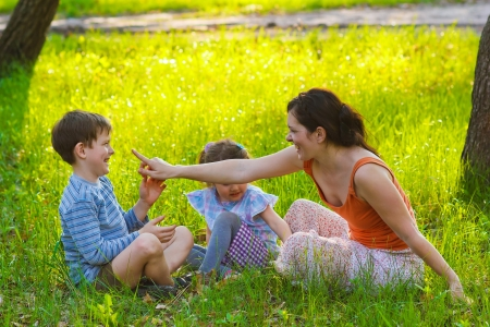 boy and girl having happiness fun woman mom son daughter photo