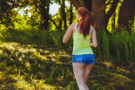 woman young brunette runner running back view outdoors, prospect healthy lifestyle, fitness sports photo