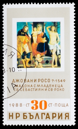 BULGARIA - CIRCA 1988: A stamp printed by BULGARIA, Giovanni Rosso 1549, madonna and Child, St. Sebastian and St. Rocco, circa 1988 photo