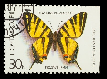 USSR - CIRCA 1987: A stamp printed in USSR, shows Butterfly Iphiclides Podalirius , from series Red Book USSR, circa 1987 photo