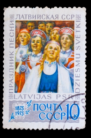 latvia girls: LATVIA - CIRCA 1978: A stamp printed in LATVIA, holiday songs, and Latvian SSR, Girls in traditional dress, circa 1978 Stock Photo