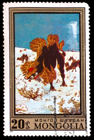 camel post: MONGOLIA - CIRCA 1972: A stamp printed by MONGOLIA , camel eats dry grass in winter, circa 1972