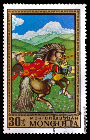 mongolia horse: MONGOLIA - CIRCA 1972: A stamp printed by MONGOLIA , rider in national dress, riding a black horse, circa 1972