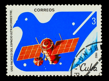 CUBA - CIRCA 1982: A stamp printed in CUBA, satellite, space station, peaceful use of outer space, circa 1982 photo