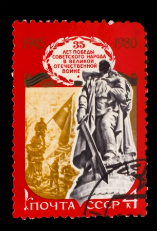 USSR - CIRCA 1980: A stamp printed in USSR, Monument to Unknown Soldier, Monument to Soviet soldiers who fell in battle against fascism, Elevation flag over Reichstag circa 1980 photo