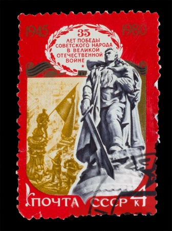 USSR - CIRCA 1980: A stamp printed in USSR, Monument to Unknown Soldier, Monument to Soviet soldiers who fell battle against fascism, Elevation flag over Reichstag, circa 1980 photo