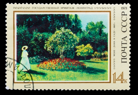 monet: USSR- CIRCA 1973: A stamp printed by USSR, painter Monet, lady in garden, 1867, State Hermitage Museum, St. Petersburg, circa 1973