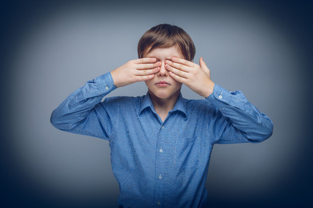 caucasian appearance: teenager boy 10 years brown hair Caucasian appearance eyes close Stock Photo