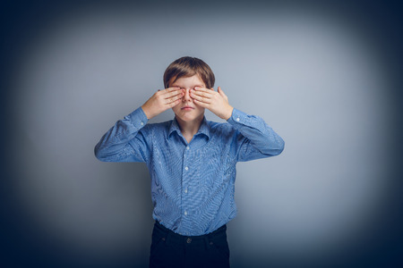 caucasian appearance: teenager boy Caucasian appearance eyes closed hands cross proces Stock Photo