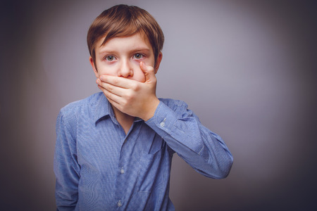 closed mouth: teenager boy of 10 years European appearance closed mouth wit