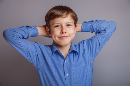 teenager boy of 10 years European appearance feels joy, portr