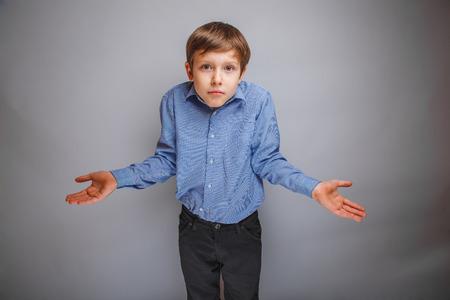 shrugs: teenager boy shrugs at a loss