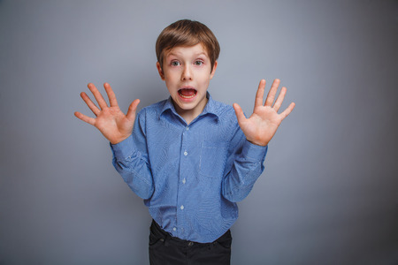 boy showing his hands gasped emotions photo