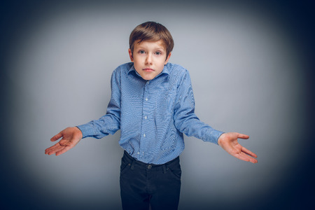 stupid body: boy teenager of European appearance brown hair threw up his hand Stock Photo