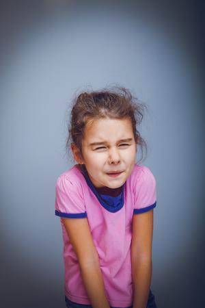 abdominal pain: teen girl 5 years of European appearance has abdominal pain  Stock Photo