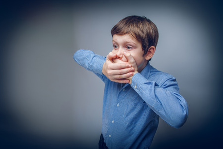 closed mouth: teenager boy 10 years of European appearance closed mouth with h