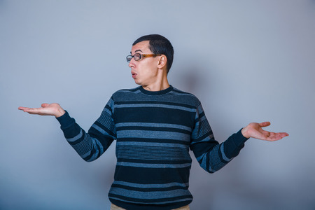 does: European -looking man  years with glasses, does  not  know Stock Photo