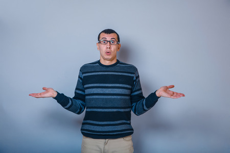 does: European-looking man years  with  glasses, does not know Stock Photo