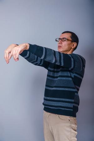 European-looking man of 30 years in glasses wants to sleep, slee