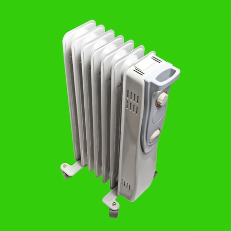 oil heater: oil electric heater Isolated on green background with clipping path