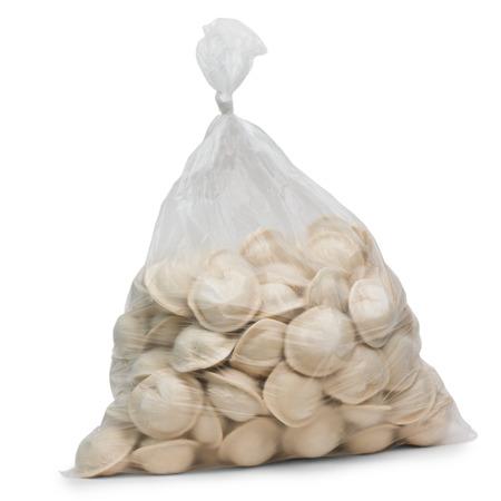 cellophane: raw dumplings in plastic cellophane bag isolated on white backgr