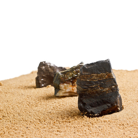 three stones in the sand texture isolated photo
