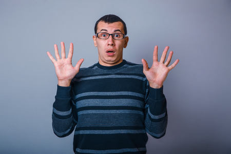 aggravated: European-looking male of about thirty raised his hands palms out Stock Photo