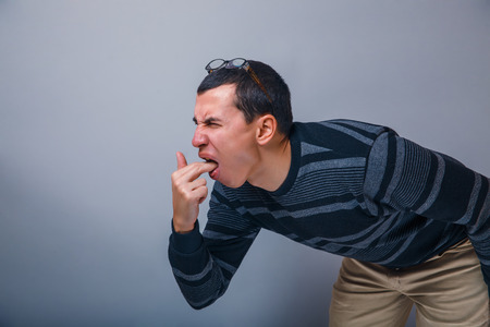 male of European appearance brunette put his fingers in mouth photo