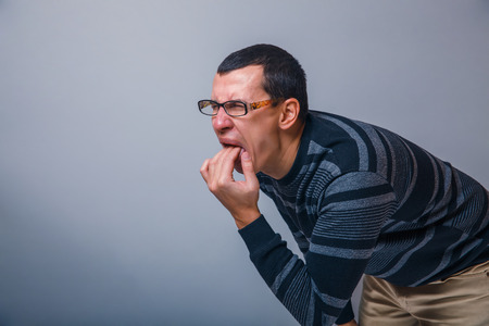male of European appearance causes vomiting putting his fingers on his mouth  photo