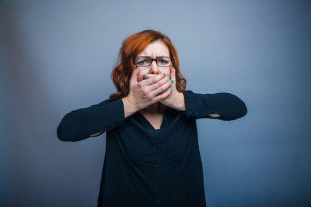 30 years: European - looking  woman 30 years  hands  over her mouth Stock Photo