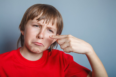 pus: European-looking boy of ten years pimple on the nose, upset over