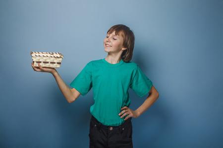 ten empty: European-looking boy of ten years holding an empty basket in han Stock Photo