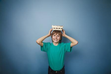 ten empty: European -looking  boy of ten years holding an empty basket in h