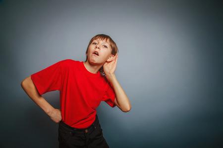 decade: European appearance boy overhears a decade, interest, ear on gra
