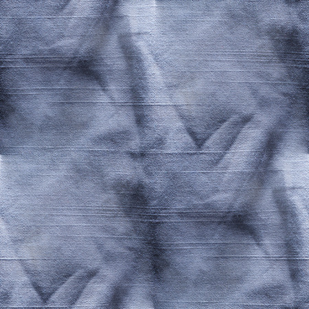 wrinkled: old wrinkled blue jeans seamless texture Stock Photo