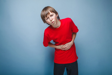 Boy teenager twelve years in the red shirt abdominal pain, gastritis, diarrhea