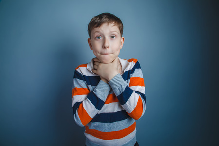 choke: teenager boy of about ten European appearance brown hair holding Stock Photo