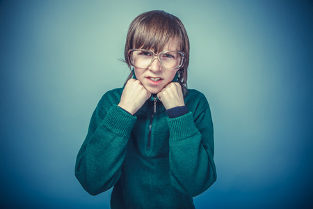 appearance: boy teenager European appearance in retro dress with glasses hol