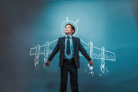 Teen boy businessman superhero pilot wings from the aircraft infographics shows the growth dynamics in the business photo Stock Photo