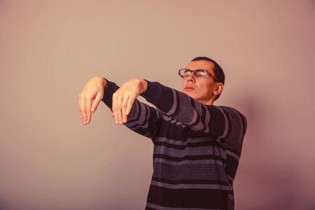 sleepwalker: European-looking man of 30 years in  glasses  wants to sleep, sleepwalking retro Stock Photo