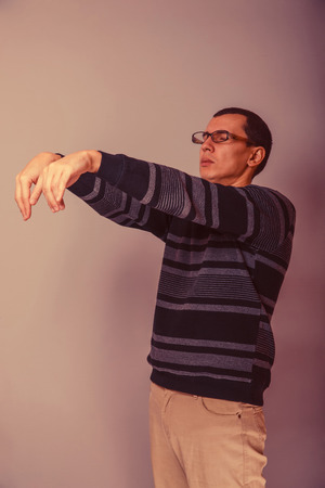 sleepwalker: European-looking man of 30 years in glasses wants to sleep, sleepwalking retro Stock Photo