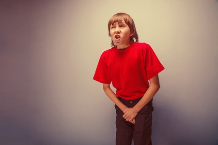 cystitis: Boy, teenager, twelve years in  red shirt wants to use  toilet, cystitis retro