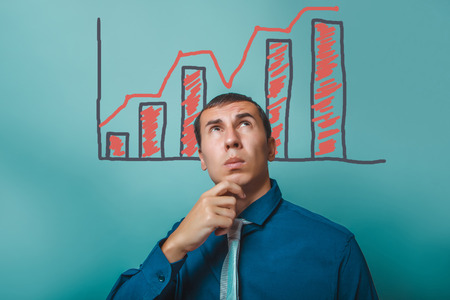 upward graph: businessman thinking man holds his chin looks upward graph growth business strategy infographics studio blue background