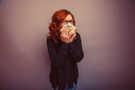handkerchief: European-looking woman of 30 years  is ill, a handkerchief retro